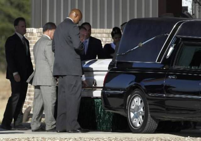The casket of Kasandra Perkins is loaded into a waiting hearse outside of Ridgeview Family Fellowship Church following a funeral service, Thursday, Dec. 6, 2012, in Blue Ridge, Texas. Perkins was shot and killed last Saturday by her boyfriend Jovan Belcher, a Kansas City Chiefs football player. AP Photo/Tony Gutierrez)