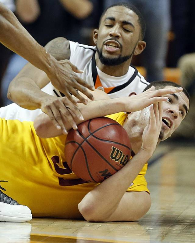 Oklahoma State Cowboys' Michael Cobbins (20) and Iowa State Cyclones' Georges Niang (31) go after a loose ball during the college basketball game between the Oklahoma State University Cowboys (OSU) and the Iowa State University Cyclones (ISU) at Gallagher-Iba Arena on Wednesday, Jan. 30, 2013, in Stillwater, Okla.  Photo by Chris Landsberger, The Oklahoman