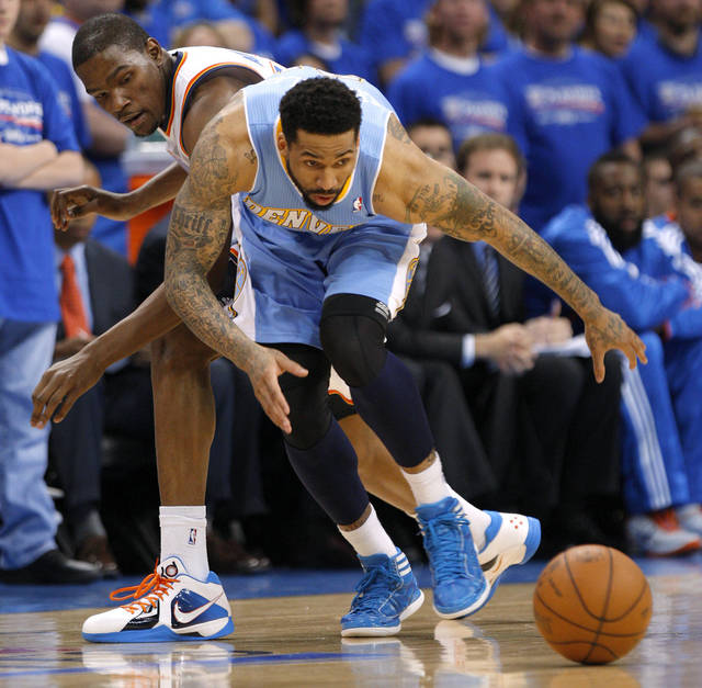 Oklahoma City's Kevin Durant (35) and Denver's Wilson Chandler (21) chase after the ball during the NBA basketball game between the Denver Nuggets and the Oklahoma City Thunder in the first round of the NBA playoffs at the Oklahoma City Arena, Sunday, April 17, 2011. Photo by Bryan Terry, The Oklahoman