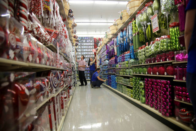 Employees stock the shelves with Christmas merchandise at Hobby Lobby, 3160 S Broadway in Edmond. Photos by DOUG HOKE, THE OKLAHOMAN