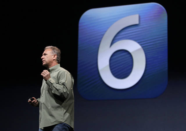 Phil Schiller, Apple's senior vice president of worldwide marketing, speaks on stage about the introduction of a new operating system during an introduction of the new iPhone 5 in San Francisco, Wednesday Sept. 12, 2012. (AP Photo/Eric Risberg)
