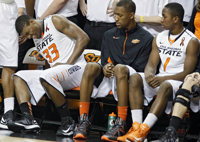 Oklahoma State 's Marcus Smart (33) goes to the bench with an injury after fouling out in the second overtime during the college basketball game between the Oklahoma State University Cowboys (OSU) and the University of Kanas Jayhawks (KU) at Gallagher-Iba Arena on Wednesday, Feb. 20, 2013, in Stillwater, Okla. Photo by Chris Landsberger, The Oklahoman