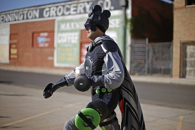 Dressed as Major Flatball, Carl Rogers from, Pauls Valley,walks down the street during International Superhero Day in Pauls Valley, Okla., Saturday, August 4, 2012.  With 124 superheroes taking part, the event attempted to set a world record for the most people in original superhero costumes in one place. The Toy & Action Figure Museum organized the day which also featured a superhero scavenger hunt, super fashion show, and a superhero party. Photo by Bryan Terry, The Oklahoman