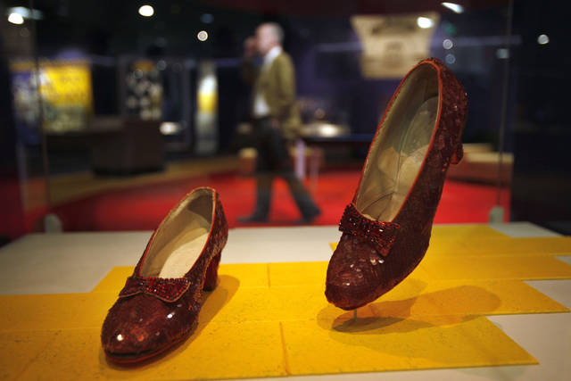 "Dorothy's Ruby Slippers, from the ""Wizard of Oz"" are seen on display as part of a new exhibit, ""American Stories,"" at the Smithsonian National Museum of American History in Washington, Wednesday, April 11, 2012. The National Museum of American History will open a new exhibit featuring iconic objects from pop culture along with objects dating back to the Pilgrims' arrival in 1620. ""American Stories"" will be a new chronology of U.S. history from the first encounters of Europeans and Native Americans to the 2008 presidential election. (AP Photo/Jacquelyn Martin)"