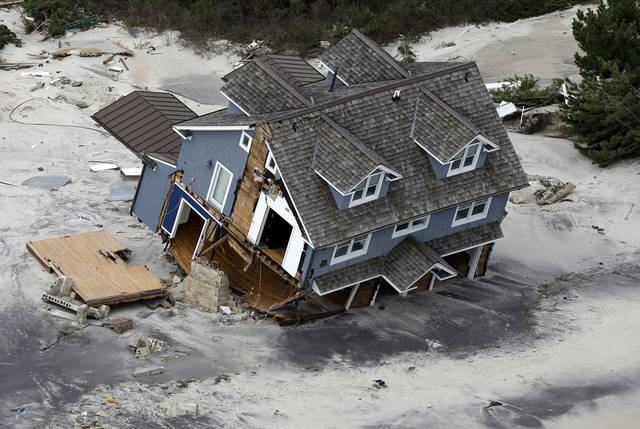 This aerial photo shows a collapsed house along the central Jersey Shore coast on Wednesday, Oct. 31, 2012. New Jersey got the brunt of Sandy, which made landfall in the state and killed six people. More than 2 million customers were without power as of Wednesday afternoon, down from a peak of 2.7 million. (AP Photo/Mike Groll) ORG XMIT: NJMG117