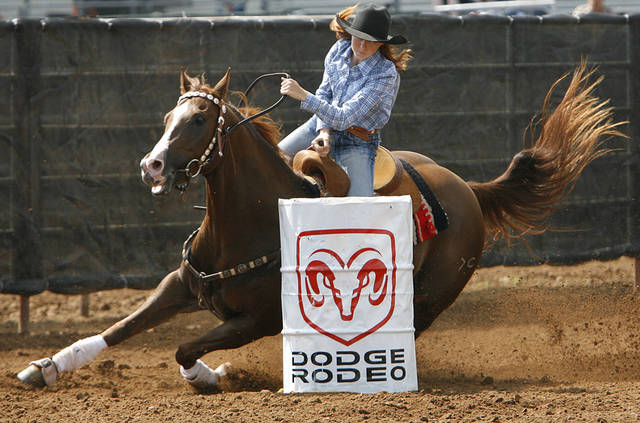 Emily Miller, of Ingalls, KS., rounds the second barrel in the barrel racing event during the second day of the International Finals Youth Rodeo at the Shawnee Expo Center on Tuesday, July 15, 2008, in Shawnee, Okla.