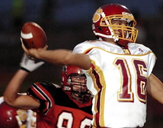 PC North quarterback  Sam  Bradford passes under pressure from Mustang's Colby Lassley in the first quarter. Mustang  High  School vs Putnam City North  High  School Friday, September 23, 2005, in Mustang Okla. Matt Strasen /The Oklahoman
