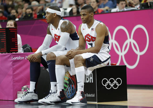 USA's Carmelo Anthony, left, and Russell Westbrook wait to enter a preliminary men's basketball game against Nigeria at the 2012 Summer Olympics, Thursday, Aug. 2, 2012, in London. (AP Photo/Eric Gay)