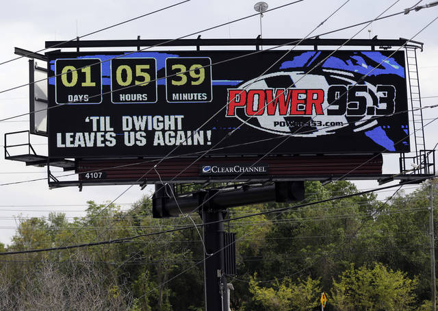 A billboard sponsored by an Orlando radio station displays a message in reference to former Orlando Magic NBA basketball player Dwight Howard, Monday, March 11, 2013, in Orlando, Fla. Last season, Howard took the Magic through a daily soap opera that ended with him becoming the second star in team history to bolt for the Los Angeles Lakers. He returns to the city he jilted Tuesday, and is prepared for a bitter reception. AP PHOTO