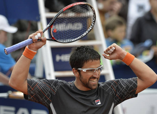 Serbia's Janko Tipsarevic celebrates after he won the final of the ATP Mercedes Cup tennis tournament against Argentinian Juan Monaco in Stuttgart, Germany, Sunday July 15, 2012. Tipsarevic won in three sets by 6-4, 5-7, and 6-3. (AP Photo/dapd Daniel Maurer)