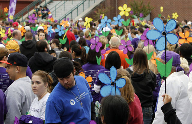 Spinning flowers are raised in the air before beginning the 2012 Oklahoma City Walk to End Alzheimer's at Bricktown Ballpark in Oklahoma City, OK, Saturday, September 15, 2012,  By Paul Hellstern, The Oklahoman