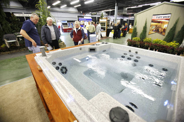 Home show-goers look at hot tubs during the Home and Garden Show at State Fair Park in Oklahoma City, OK, Friday, Jan. 20, 2012. By Paul Hellstern, The Oklahoman