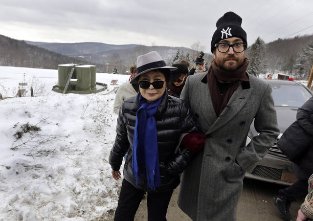 "FILE - In this file photo of Jan. 17, 2013, Yoko Ono, left, and her son Sean Lennon visit a fracking site in Franklin Forks, Pa., during a bus tour of natural-gas drilling sites in northeastern Pennsylvania. Ono and Lennon have formed a group called ""Artists Against Fracking,"" which has become the main celebrity driven anti-fracking organization.  (AP Photo/Richard Drew, File) ORG XMIT: NYR406"