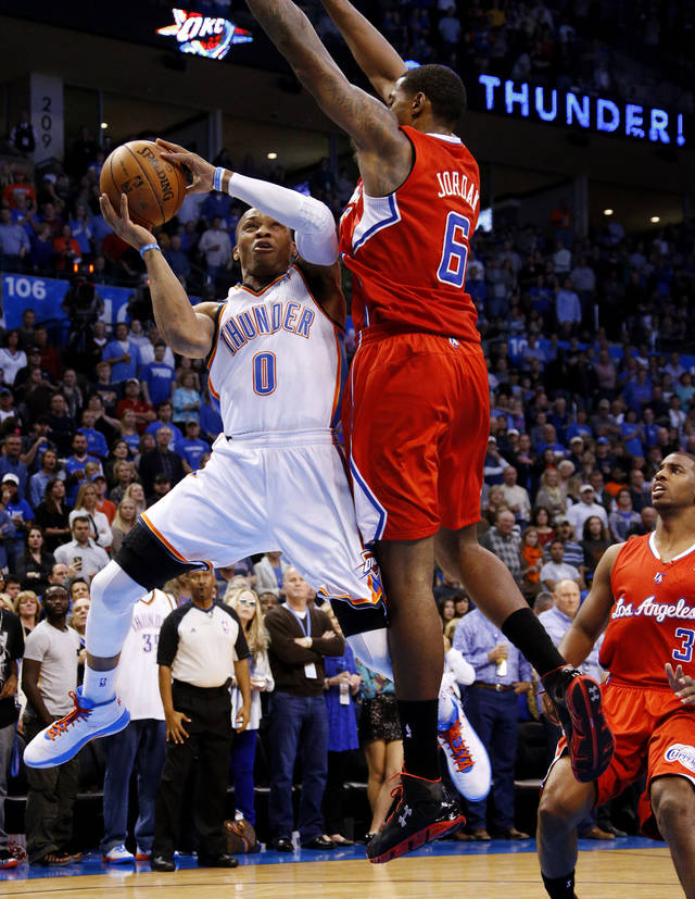 Oklahoma City's Russell Westbrook (0) goes to the basket beside the Clippers DeAndre Jordan (6) during an NBA basketball game between the Oklahoma City Thunder and the Los Angeles Clippers at Chesapeake Energy Arena in Oklahoma City, Wednesday, Nov. 21, 2012. Photo by Bryan Terry, The Oklahoman