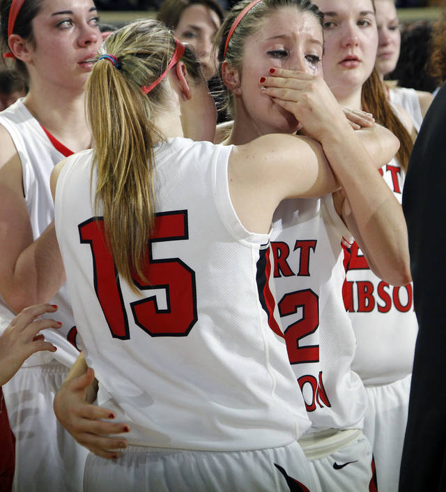 Ft. Gibson's Kirby Parnell (15) and Julia Hill (22) wipe the tears away after the loss to Anadarko during the 4A girls State Basketball Championship game between Ft. Gibson High School and Anadarko High School at State Fair Arena on Saturday, March 10, 2012 in Oklahoma City, Okla.  Photo by Chris Landsberger, The Oklahoman