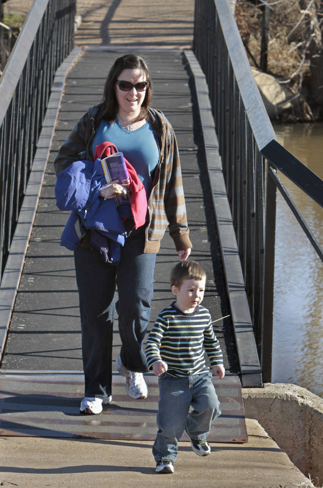Misty Foley-McKenna and two-year-old son Sean head for the playground at Lions Park Northeast as they enjoy warm weather on Thursday, Jan. 5, 2012, in Norman, Okla.  Photo by Steve Sisney, The Oklahoman