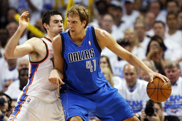 Dallas' Dirk Nowitzki (41) works the ball against Oklahoma City's Nick Collison (4) during Game 2 of the first round in the NBA basketball  playoffs between the Oklahoma City Thunder and the Dallas Mavericks at Chesapeake Energy Arena in Oklahoma City, Monday, April 30, 2012.  Oklahoma City won, 102-99. Photo by Nate Billings, The Oklahoman
