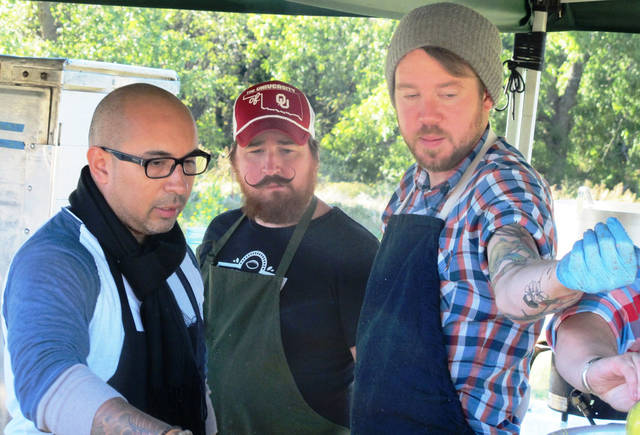 Chefs Pepe Rodriguez, Josh Valentine and Jonathon Stranger prepare to serve the first course at Outstanding in the Field.