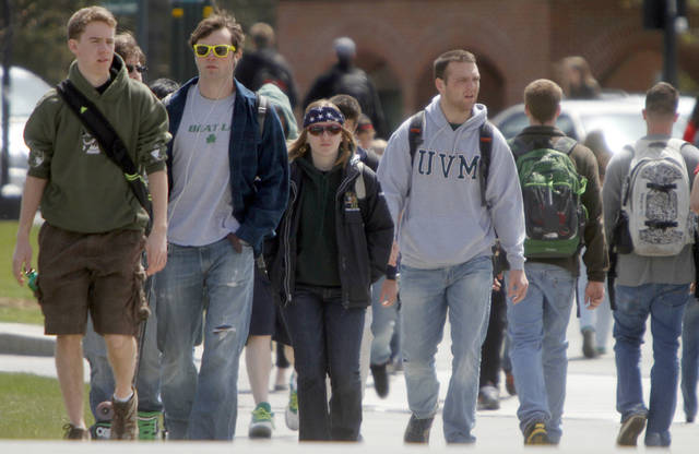FILE-In this April 30, 2012, file photo, students walk across campus at the University of Vermont in Burlington, Vt. The sticker price of in-state tuition at four-year public universities climbed about $400 this fall, an increase of nearly 5 percent that brought the average to $8,655. That's a modest increase compared to recent years but still painful for families with stagnant incomes after a prolonged economic slump. New Hampshire and Vermont have the highest published in-state tuition charges, at around $14,000 each. Wyoming has the lowest at $4,287, followed by Utah at $5,595.(AP Photo/Toby Talbot)