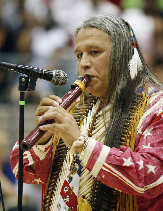 Native American musician Albert Gray Eagle performs on an Indian flute during a multicultural performance day at Edmond Santa Fe High School in Edmond, OK, Friday, March 14, 2008. BY PAUL HELLSTERN, THE OKLAHOMAN ORG XMIT: KOD