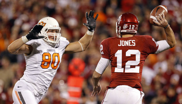 BEDLAM FOOTBALL: Oklahoma State's Cooper Bassett (80) pressures Oklahoma's Landry Jones (12) during the Bedlam college football game between the University of Oklahoma Sooners (OU) and the Oklahoma State University Cowboys (OSU) at Gaylord Family-Oklahoma Memorial Stadium in Norman, Okla., Saturday, Nov. 24, 2012. OU won 51-48 in overtime. Photo by Sarah Phipps, The Oklahoman