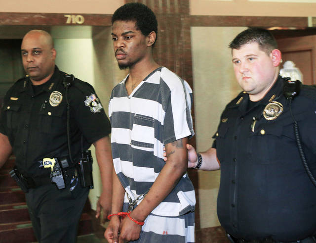 Lester Kinchion, 21, leaves an Oklahoma County courtroom Thursday after receiving a life sentence in the death of Jeffery McCoy, a parole and probation officer. Photo by Bryan Terry, The Oklahoman