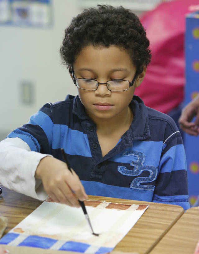Tim Budd, a fourth-grader at Orvis Risner Elementary School, paints during art class. Photo By Steve Gooch, The Oklahoman <strong>Steve Gooch - The Oklahoman</strong>