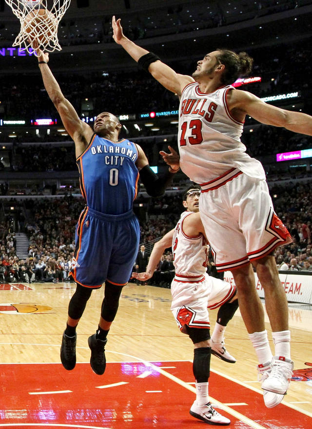 Oklahoma City Thunder guard Russell Westbrook (0) shoots over Chicago Bulls center Joakim Noah during the second half of an NBA basketball game, Thursday, Nov. 8, 2012, in Chicago. The Thunder won 97-91. (AP Photo/Charles Rex Arbogast) ORG XMIT: CXA110