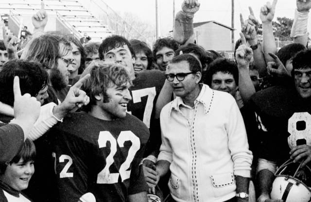 FILE - In this undated 1976 photo, St. John's University football coach John Gagliardi is shown after St. John's University defeated Towson State in the Division III national title game in Phenix City, Ala. Gagliardi, the winningest coach in college football history, is retiring from Division III St. John's University in Minnesota. Gagliardi announced his decision on the team website on Monday, Nov. 19, 2012. (AP Photo/St. Cloud Times) NO SALES