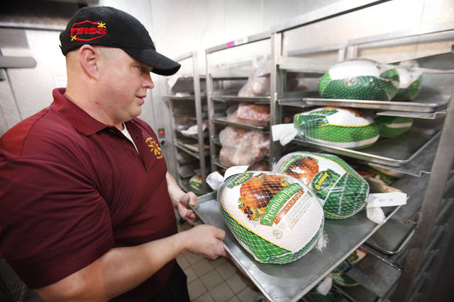 Food service manager Billy Belvin checks the turkeys Wednesday for Thanksgiving dinner the following day at Fort SillPHoto ByDavid McDaniel, The Oklahoman