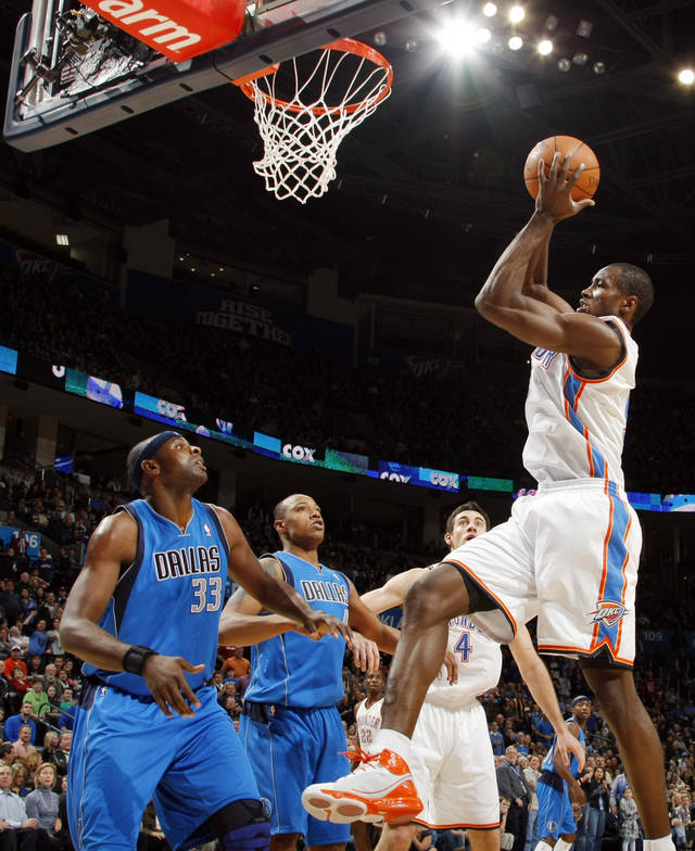 Oklahoma City's Serge Ibaka (9) looks to score in front of Brendan Haywood (33) and Caron Butler (4) of Dallas next to Oklahoma City's Nick Collison (4) during the NBA basketball game between the Dallas Mavericks and the Oklahoma City Thunder at the Oklahoma City Arena in Oklahoma City, Monday, Dec. 27, 2010. Photo by Nate Billings, The Oklahoman