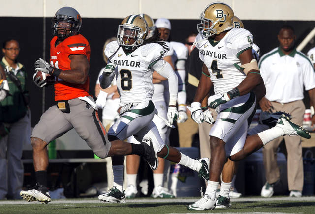 Oklahoma State's Jeremy Smith (31) tries to out run Baylor's K.J. Morton (8) and Elliot Coffey (4) during a college football game between the Oklahoma State University Cowboys (OSU) and the Baylor University Bears (BU) at Boone Pickens Stadium in Stillwater, Okla., Saturday, Oct. 29, 2011. Photo by Sarah Phipps, The Oklahoman