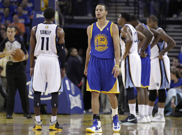 Golden State Warriors' Stehen Curry (30) reacts after teammate Brandon Rush left the game after sustaining a knee injury during the first quarter of an NBA basketball game against the Memphis Grizzlies Friday, Nov. 2, 2012, in Oakland, Calif. (AP Photo/Ben Margot)