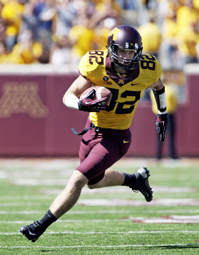 FILE - In this Sept. 15, 2012 file photo, Minnesota wide receiver A.J. Barker heads to the end zone on a 53-yard touchdown catch during an NCAA college football game in Minneapolis. Barker quit the team Sunday, Nov. 18, 2012, in a blistering email to coach Jerry Kill that he subsequently made public through his personal blog, the messy fallout triggered by their conflict about the treatment of the junior's sprained right ankle. (AP Photo/Paul Battaglia, File)