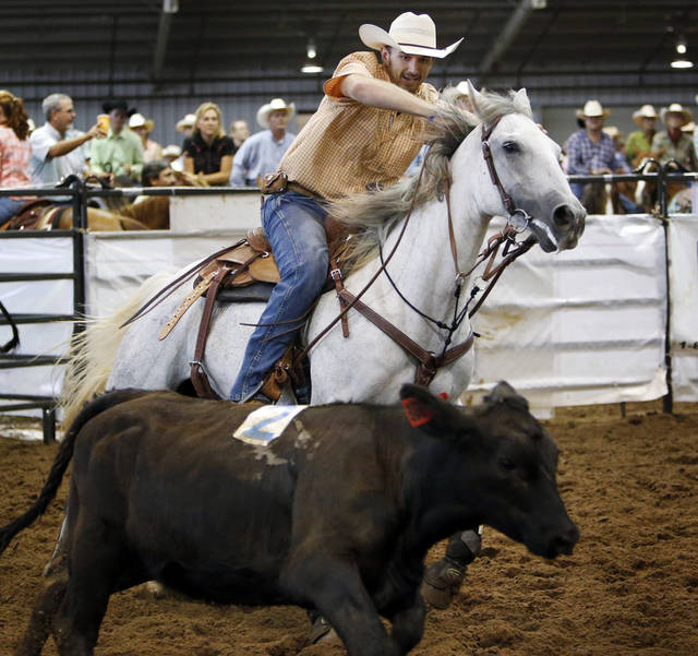 Travis Terrebonne, of Larose, La., competes in the National Finals for the Ranch Sorting National Championships during the Battle in the Saddle at the State Fair Park in Oklahoma City, Thursday, July 5, 2012. Photo by Nate Billings, The Oklahoman