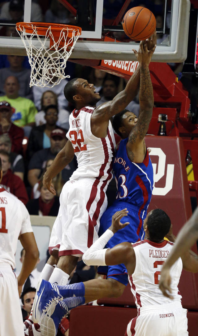 Oklahoma's Amath M'Baye (22) blocks a shot by Kansas' Ben McLemore (23) as the University of Oklahoma Sooners (OU) play the Kansas Jayhawks (KU) in NCAA, men's college basketball at The Lloyd Noble Center on Saturday, Feb. 9, 2013 in Norman, Okla. Photo by Steve Sisney, The Oklahoman