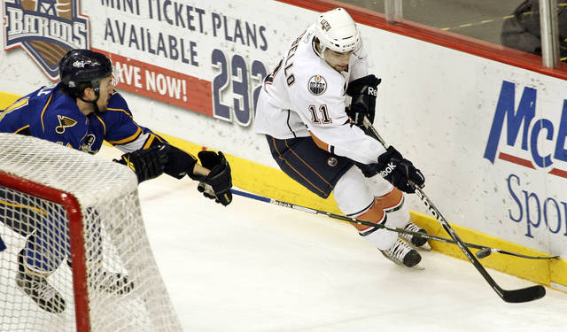 Peoria's Daryl Boyle (41) tries to knock the puck away from Oklahoma City's Mark Arcobello (11) during the AHL hockey game between the Peoria Rivermen and the Oklahoma City Barons at the Cox Convention Center  in Oklahoma City, Thursday, Feb. 3, 2011. Photo by Nate Billings, The Oklahoman ORG XMIT: KOD