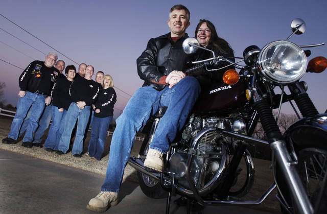 Terry Watts and his wife with the motorcycle F.A.I.T.H. Riders of Chisholm Heights Baptist Church rebuilt while he was in Kuwait in Mustang Tuesday, Jan. 18, 2012. Photo by Doug Hoke, The Oklahoman