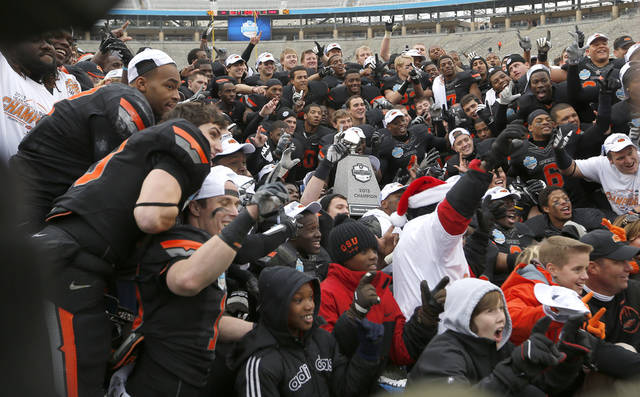 OSU celebrates their win following the Heart of Dallas Bowl football game between the Oklahoma State University (OSU) and Purdue University at the Cotton Bowl in Dallas,  Tuesday,Jan. 1, 2013. Photo by Sarah Phipps, The Oklahoman