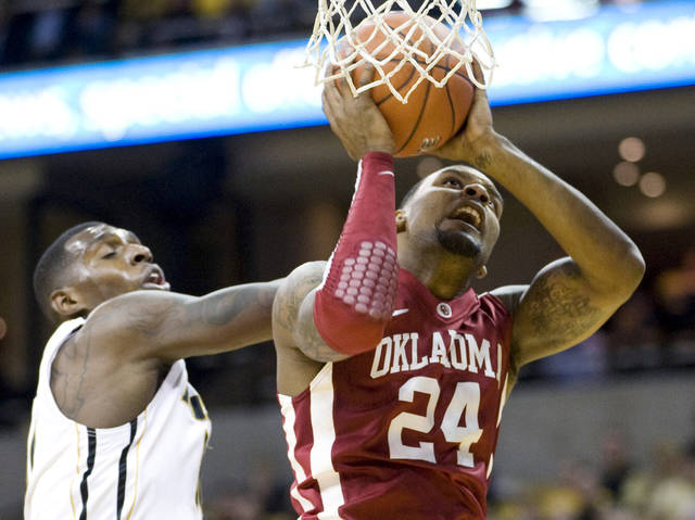 Oklahoma's Romero Osby, right, shoots past Missouri's Ricardo Ratliffe during the first half of an NCAA college basketball  game Tuesday, Jan. 3, 2012, in Columbia, Mo. (AP Photo/L.G. Patterson) ORG XMIT: MOLG101