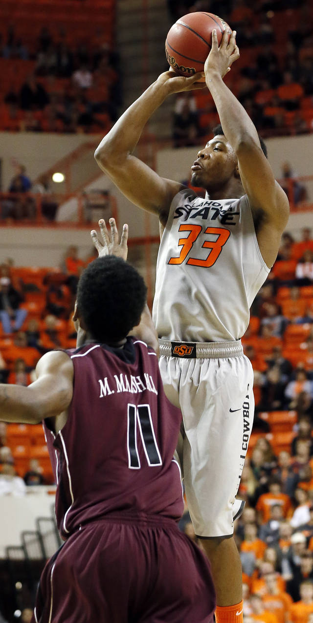 OSU's Marcus Smart (33) shoots over Marcus Marshall (11) of Missouri State during a men's college basketball between Oklahoma State University and Missouri State at Gallagher-Iba Arena in Stillwater, Okla., Saturday, Dec. 8, 2012. Photo by Nate Billings, The Oklahoman
