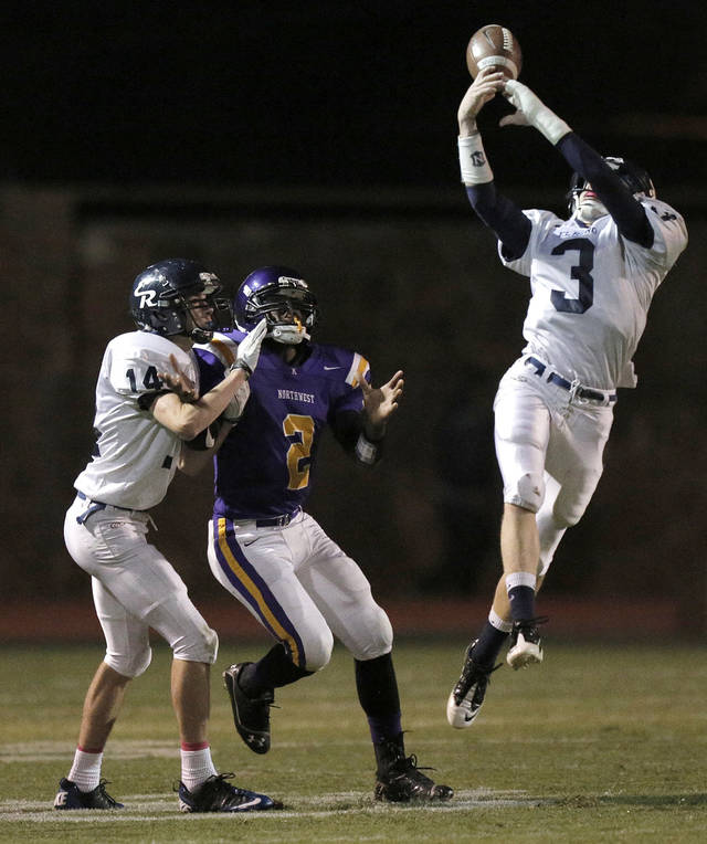 El Reno's Cal Baker (3) intercepts a pass intended for NWC's Fre'Darian Ashley (2) during a high school football game between Northwest Classen and El Reno at Taft Stadium in Oklahoma City, Friday, Oct. 5, 2012.  Photo by Garett Fisbeck, The Oklahoman