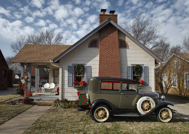 A house at 438 Lahoma Avenue shows an early Ford Automobile with Christmas presents and decorations on Thursday, Dec. 22, 2011, in Norman, Okla.   Photo by Steve Sisney, The Oklahoman