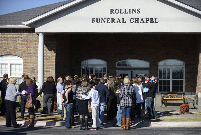 Mourners gather outside the chapel at Rollins Funeral Home in Rogers, Ark., Tuesday, Nov. 27, 2012, following a funeral service for 6-year-old Jersey Bridgeman. The child was found dead in an abandoned house near her home shortly after she was reported missing Nov. 20. A neighbor has been arrested in connection to the murder. (AP Photo/NWA Media, Marc F. Henning)