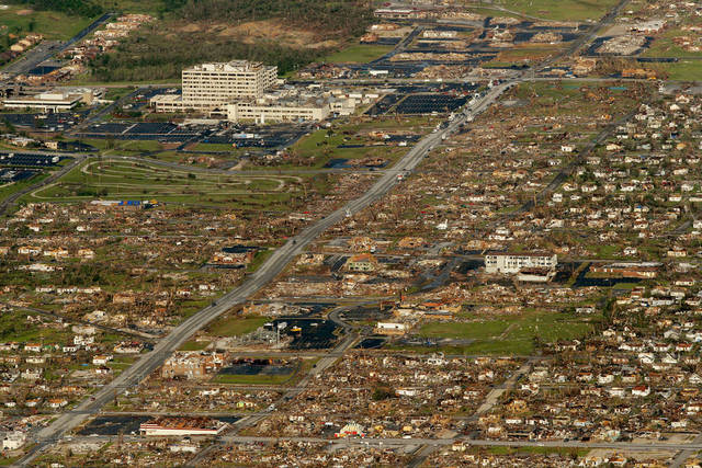 FOR USE AS DESIRED, YEAR END PHOTOS - FILE -In this May 24, 2011 file photo, the path of a powerful tornado is seen in Joplin, Mo. (AP Photo/Charlie Riedel, File) ORG XMIT: NYYE300