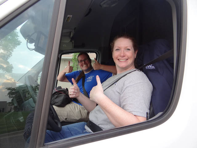 Samantha Burnett, left, and Lexie Parker give thumbs up after delivering 19 pets to the Golden Valley location of the Animal Humane Society of Minnesota. Photo provided. <strong></strong>