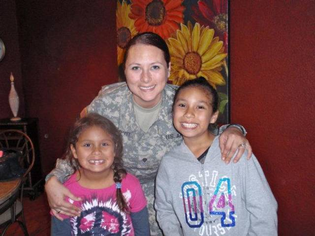 Jj Murphy, a member of the 45th Infantry Brigade, smiles with her two daughters, Seneca and Shoshoni. Murphy and her husband, Chad, were both deployed at the same time. PHOTO BY Leslie Metzger, For The Oklahoman