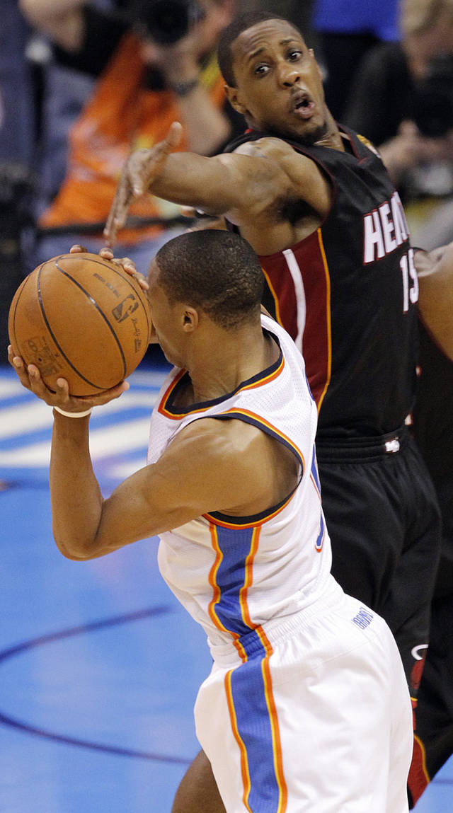 Miami's Mario Chalmers (15) defends on Oklahoma City's Russell Westbrook (0) during Game 2 of the NBA Finals between the Oklahoma City Thunder and the Miami Heat at Chesapeake Energy Arena in Oklahoma City, Thursday, June 14, 2012. Photo by Chris Landsberger, The Oklahoman