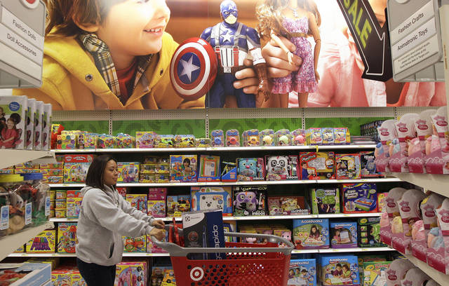 A woman walks through the toy department at a Target store in Colma, Calif., Friday, Nov. 23, 2012. Black Friday, the day when retailers traditionally turn a profit for the year, got a jump start this year as many stores opened just as families were finishing up Thanksgiving dinner. (AP Photo/Jeff Chiu)