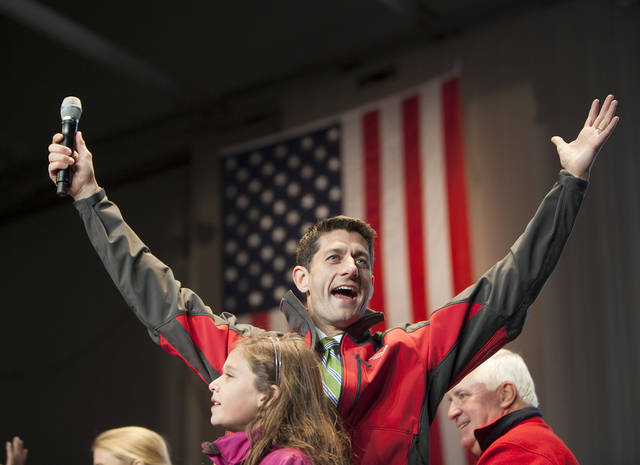 Republican vice presidential candidate, Paul Ryan, acknowledges the crowd that filled an airplane hanger at Harrisburg International Airport during a campaign stop in Middletown, Pa. on Saturday Nov. 4, 2012. (AP Photo/The Patriot-News, Mark Pynes)